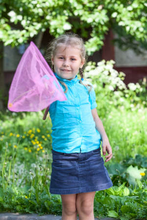 Happy Caucasian child showing butterfly net photo
