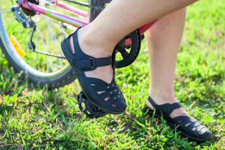 bicycle pedal: Closeup view of cyclist feet on pedals of bicycle Stock Photo