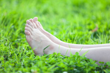 barefooted: Barefooted beautiful female feet on green grass