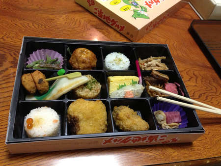 bento box: Japanese bento box lunch is on table
