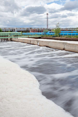 greywater: Aeration volumes for water in wastewater treatment plant  Long exposure Stock Photo