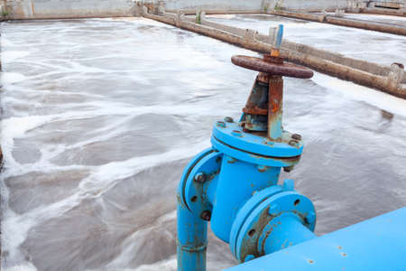 Industrial tap with blue pipeline for oxygen blowing into sewage water photo