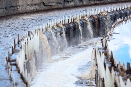 effluent: Water overflowing from round settlers, long exposure Stock Photo