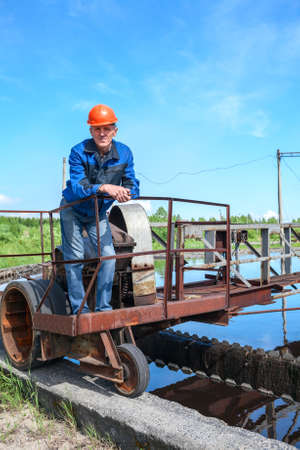 effluent: Portrait of senior engineering worker in the water treatment plant Stock Photo