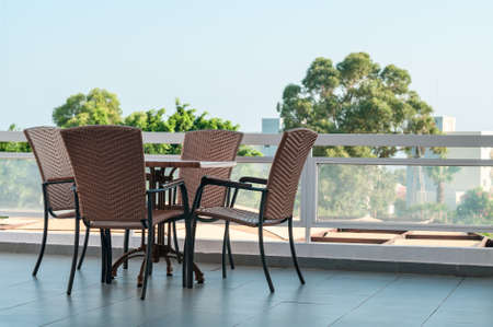 Open-air terrace with furniture in apartments