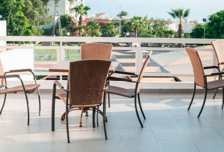 Table with chairs standing on open air balcony photo