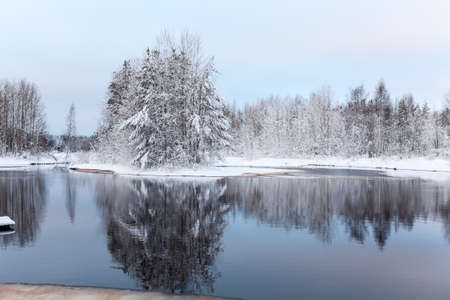 Warm lake with Melted water puddle in forest during strong freeze photo