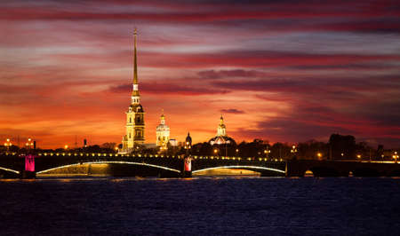 tourism russia: The Peter and Paul Cathedral and fortress with Trinity bridge at night in Saint-Petersburg, Russia.