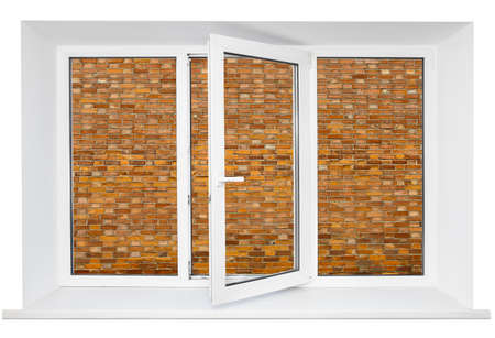 triplex: White plastic cutout triple door window with brick wall inside Stock Photo