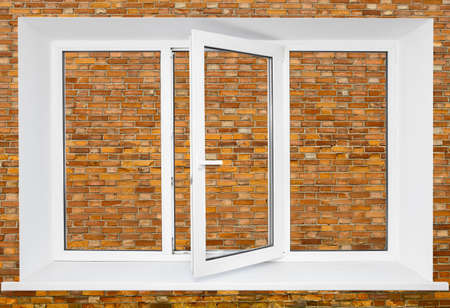 triplex: White plastic triple door window on brick wall background