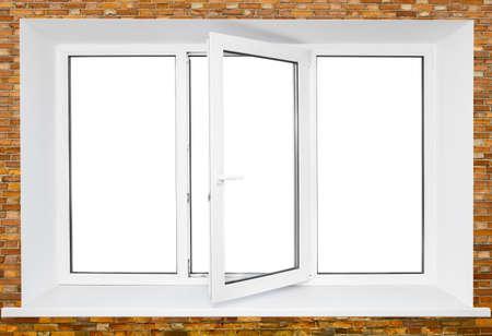 White plastic triple door window on brick wall with cutou area inside