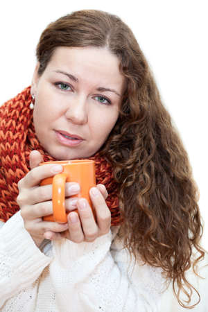 Young sick woman with a cup of tea in her hand isolated on white background photo