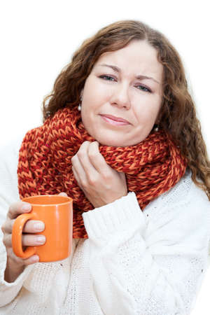 tremble: Ill woman holding a mug of tea with sore throat isolated on white background