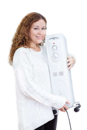 calorifer: Woman in white sweater with heater in hands on isolated background