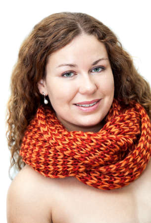 Happy young woman with naked torso in neck scarf  photo