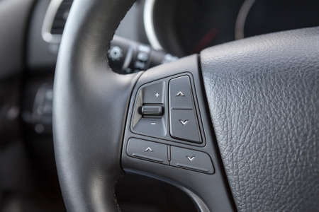 Control buttons on the steering wheel of a car photo