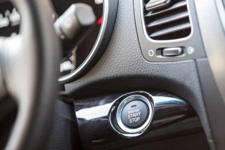 Car interior, engine start button under the steering wheel Stock Photo - 24425639