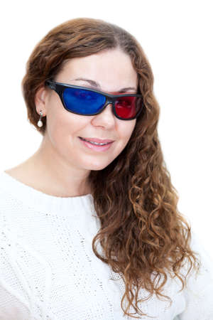 Portrait of attractive girl with curly hair dressed with 3D glasses, white background photo