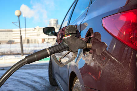 Close up view of car refuel in gas station Stock Photo