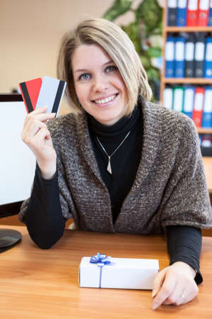 Woman buying goods with credit card photo