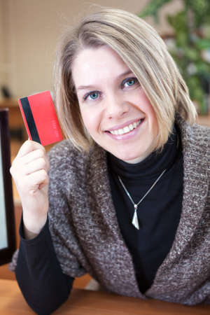 Credit card in hand of young attractive woman photo