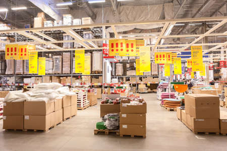 household money: SAINT-PETERSBURG, RUSSIA - CIRCA JANUARY: Commerce warehouse hall in Ikea store. IKEA is a one of the worlds largest retailers selling furniture and household goods Editorial
