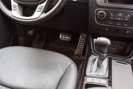 Drivers seat with the gear lever. Car interior photo