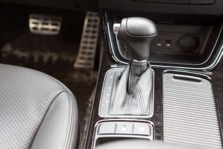 Gearshift lever of automatic gearbox. Car interior photo