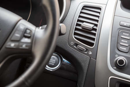 Interior of vehicle with automatic start engine button photo
