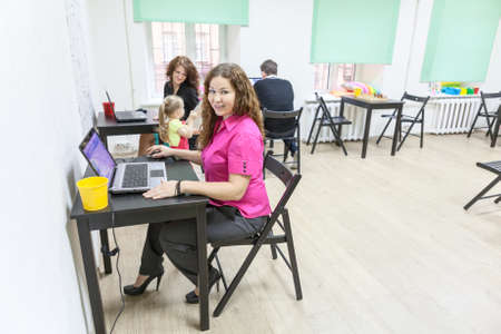 freelancers: Co-working room with happy working people Stock Photo