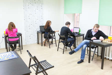 freelancers: Young adults surfing internet in co-working room