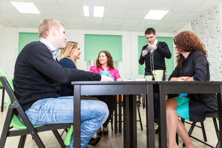 office party: Young adults spending time at the exciting table games Stock Photo