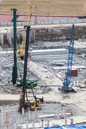 piling: Construction site with machinery for piling into the ground