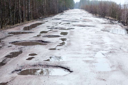 black hole: Holes and puddles on bad broken road