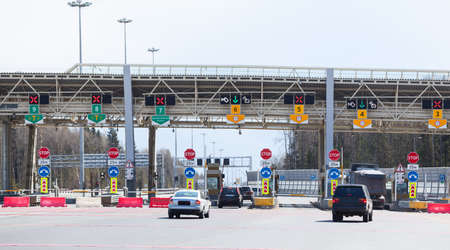 turnpike: Point payment of travel on toll road with riding vehicles Stock Photo