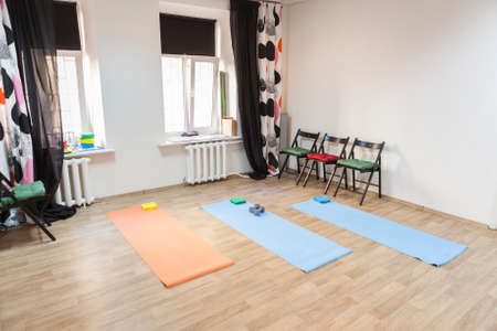 health care facility: Gym with mats and exercising materials prepared for yoga