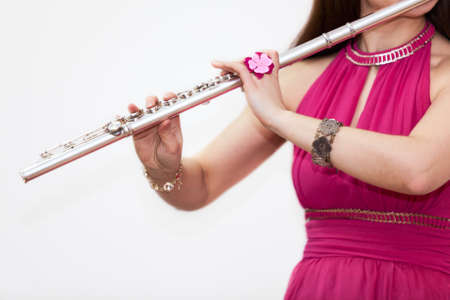 silver flute: Cropped view of woman playing on silver flute