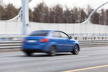 Blured car riding on road, speed way photo