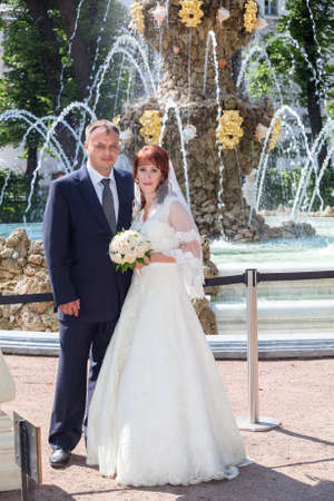 beauty fountain: Caucasian wedding couple standing against beauty fountain