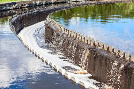 purifying: Water overflowing from water treatment settlers Stock Photo