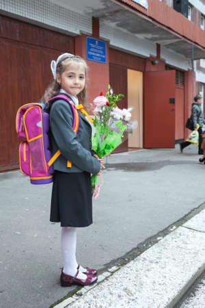 Little schoolgirl portrait near her school Stock Photo