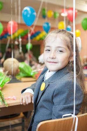 grade schooler: Little schoolgirl sitting at desk in school