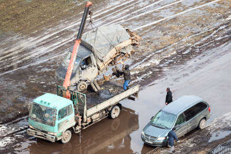banding: SAINT-PETERSBURG, RUSSIA - CIRCA FEBRUARY, 2014: Tow truck loads banding after road crash freight car for scrappage. Government scrappage scheme Editorial