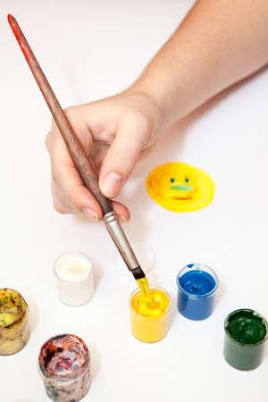 craft man: Human hands drawing sun with brush