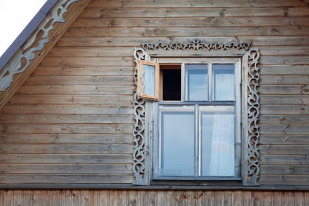 roof ridge: Wooden frame window in roof ridge Stock Photo