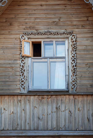 panes: Wooden frame window  with opened leaf in house