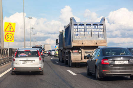 SAINT-PETERSBURG, RUSSIA - CIRCA AUGUST, 2014: Traffic jam is on highway due construction works on the road. Cars slows and drives to the exit. City the Ring Road Editorial