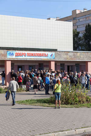 budgetary: SAINT-PETERSBURG, RUSSIA - CIRCA AUGUST, 2014: Crowd of people stand in queue to buy swimming season ticket for a child. A small quantity of budgetary places for preschoolers in sports department. Editorial