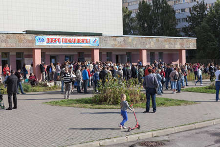SAINT-PETERSBURG, RUSSIA - CIRCA AUGUST, 2014: Crowd of people stand in queue to buy swimming season ticket for a kids. A small quantity of budgetary places for children in sports department.