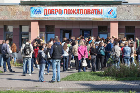 SAINT-PETERSBURG, RUSSIA - CIRCA AUGUST, 2014: Crowd of people stand in queue to buy swimming season ticket for a child. A small quantity of budgetary places for preschoolers in sports department.